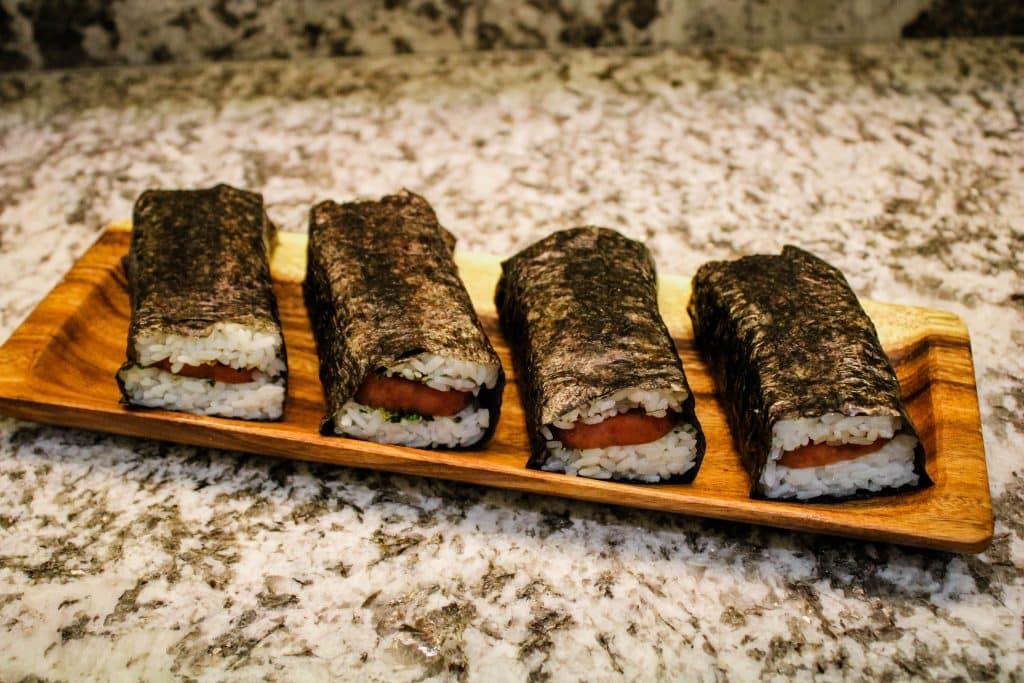 4 musubi on a wood platter