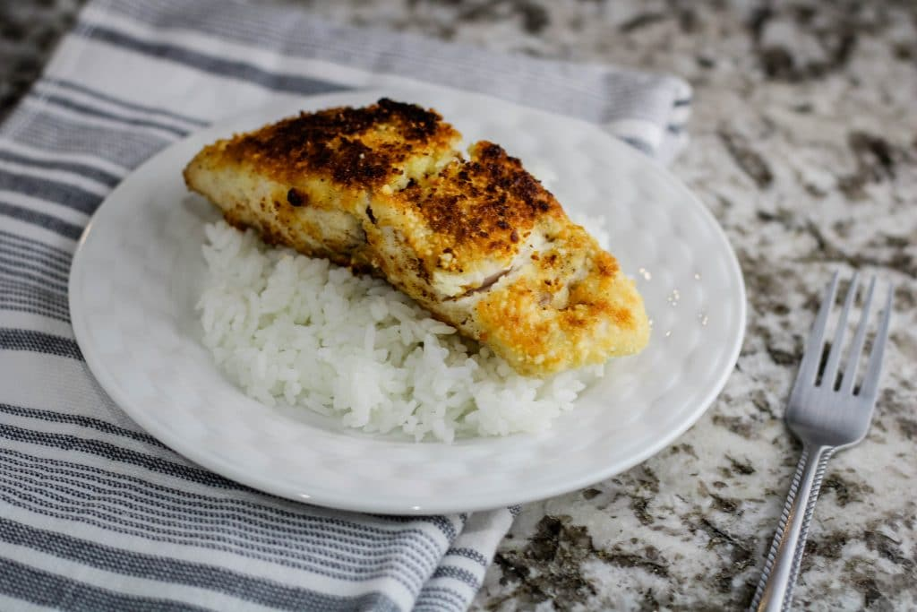 macadamia nut crusted mahi mahi on a bed of white rice