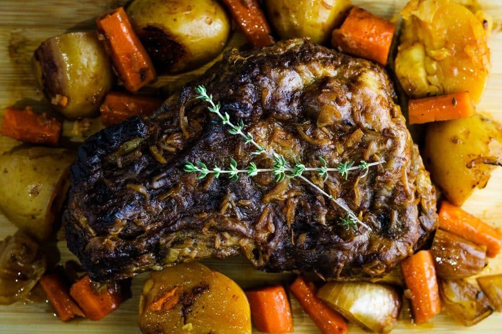 top down view of crock pot pot roast and vegetables