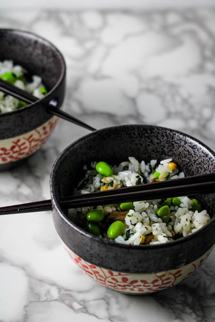 two bowls of rice with chopsticks