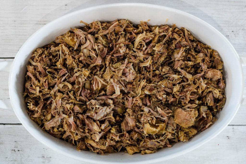 top down view of kalua pig in a serving dish