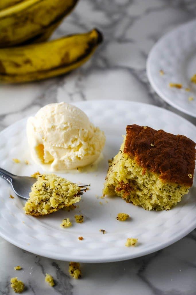 banana bread on a plate with vanilla ice cream