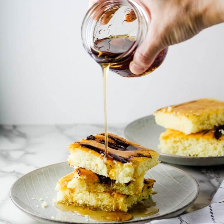 syrup pouring on sheet pan pancakes