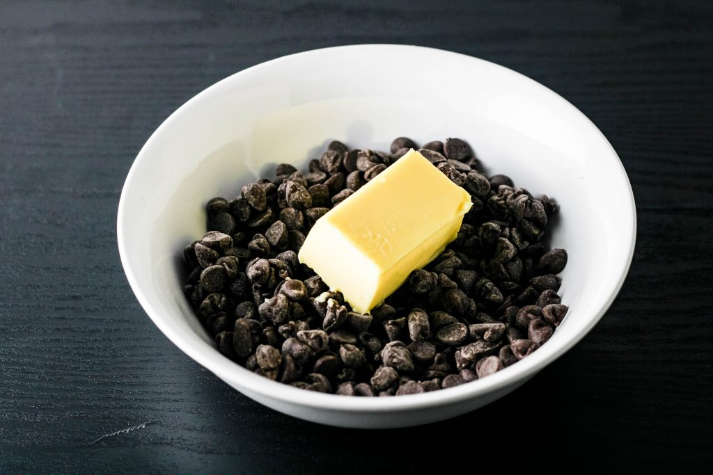semi sweet chocolate chips and butter in a white bowl
