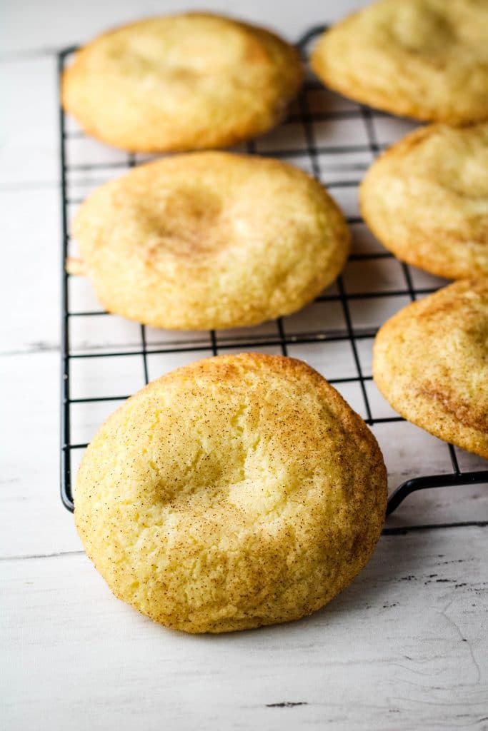 snickerdoodle cookies on a cooling rack