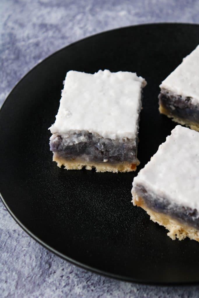 black plate with 3 sweet potato haupia pie bars