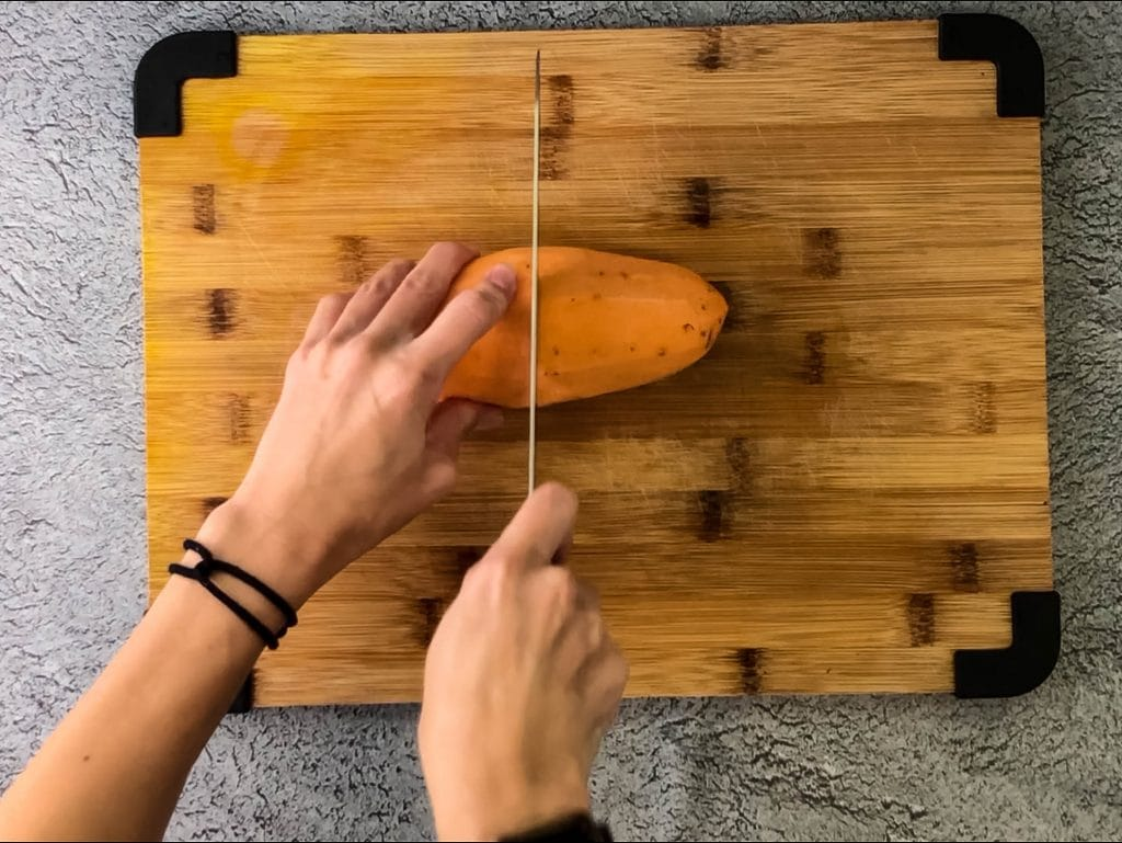 cutting a sweet potato in half