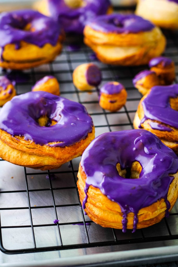 ube glazed air fryer donuts on a tray