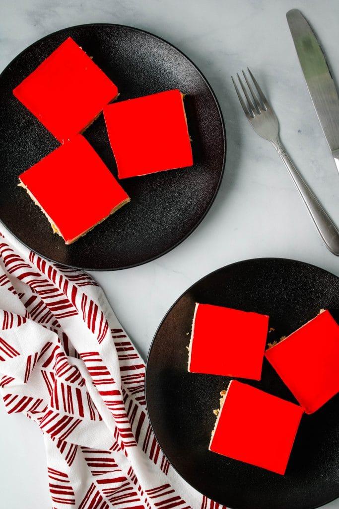 jello cream cheese squares on black plates