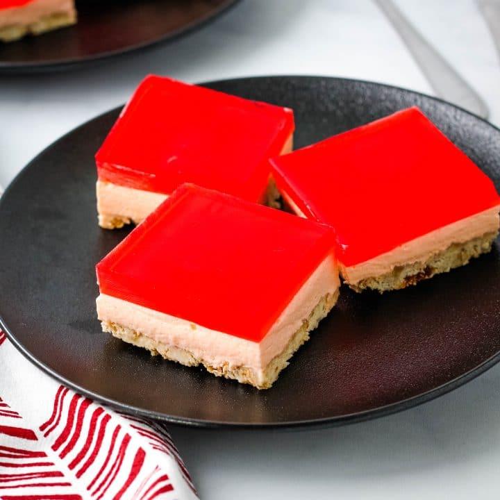 jello cream cheese on a black plate