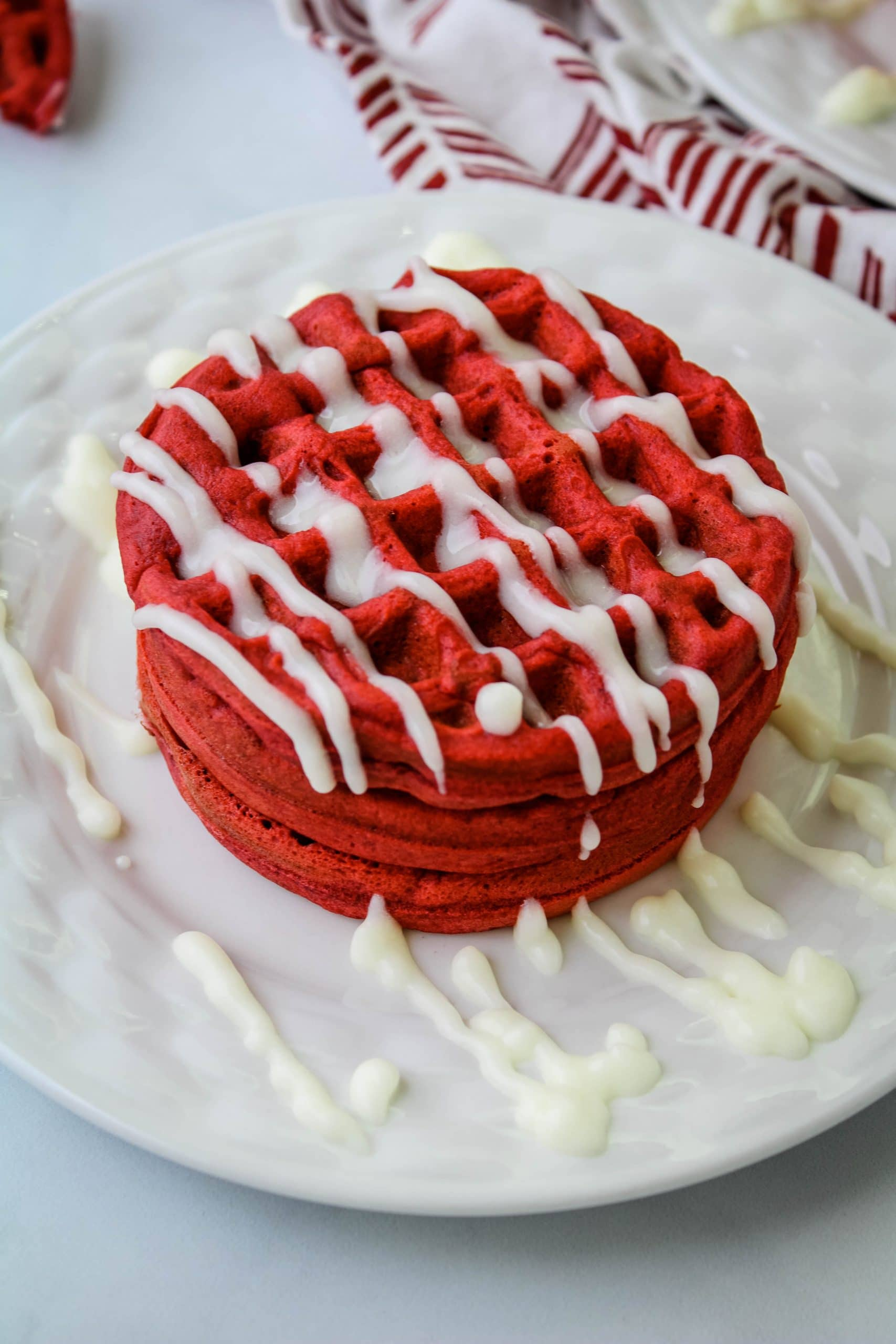red velvet mochi waffles with cream cheese drizzle