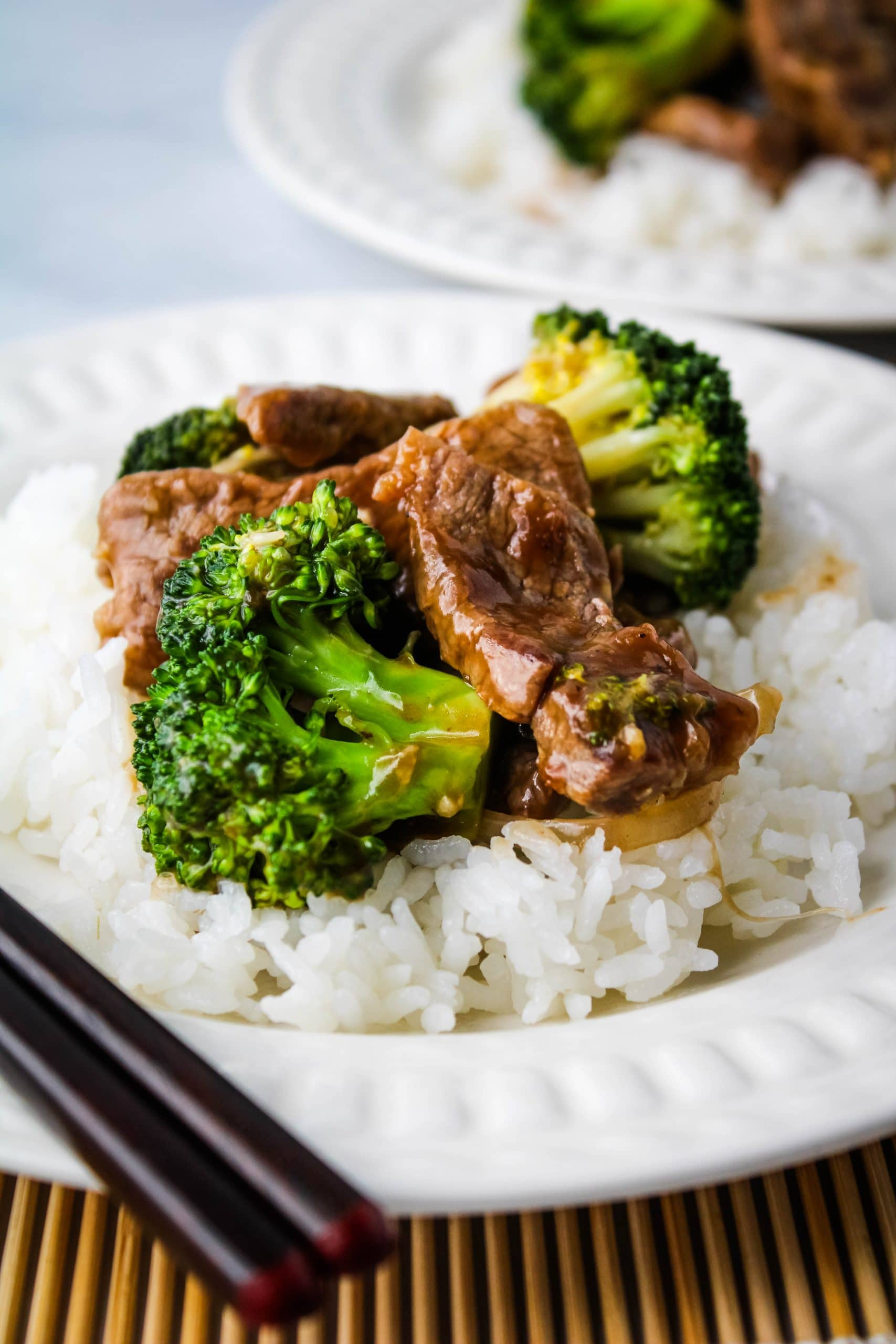 beef broccoli with rice on a white plate
