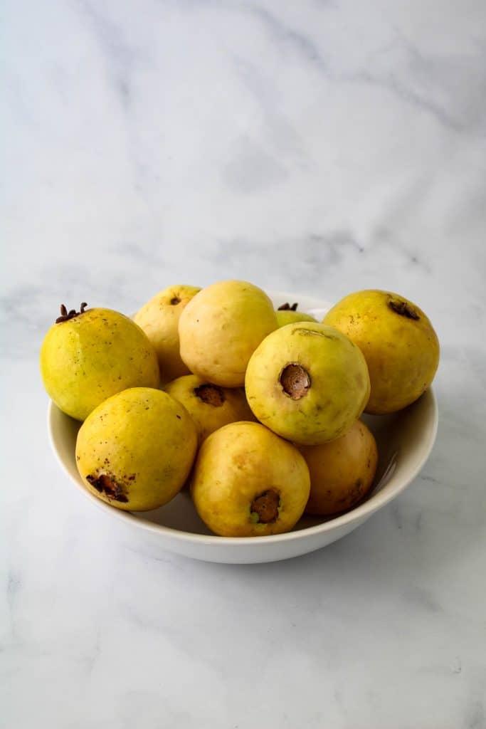 guavas in a white bowl