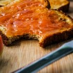 guava jam on toast with a bite out of the toast