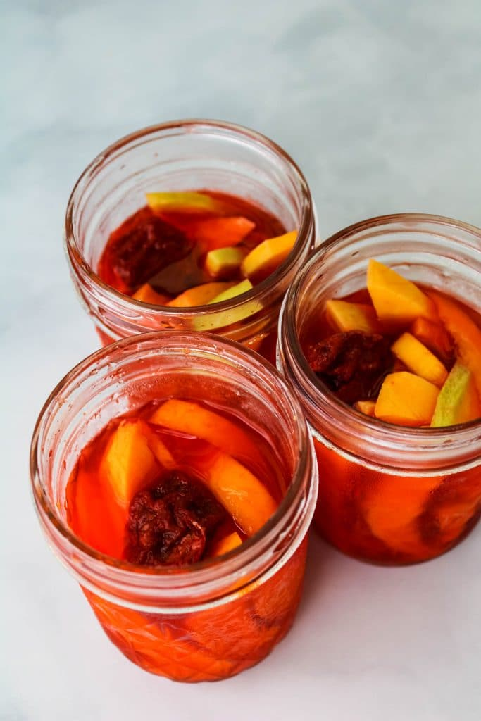 pickled mango in mason jars