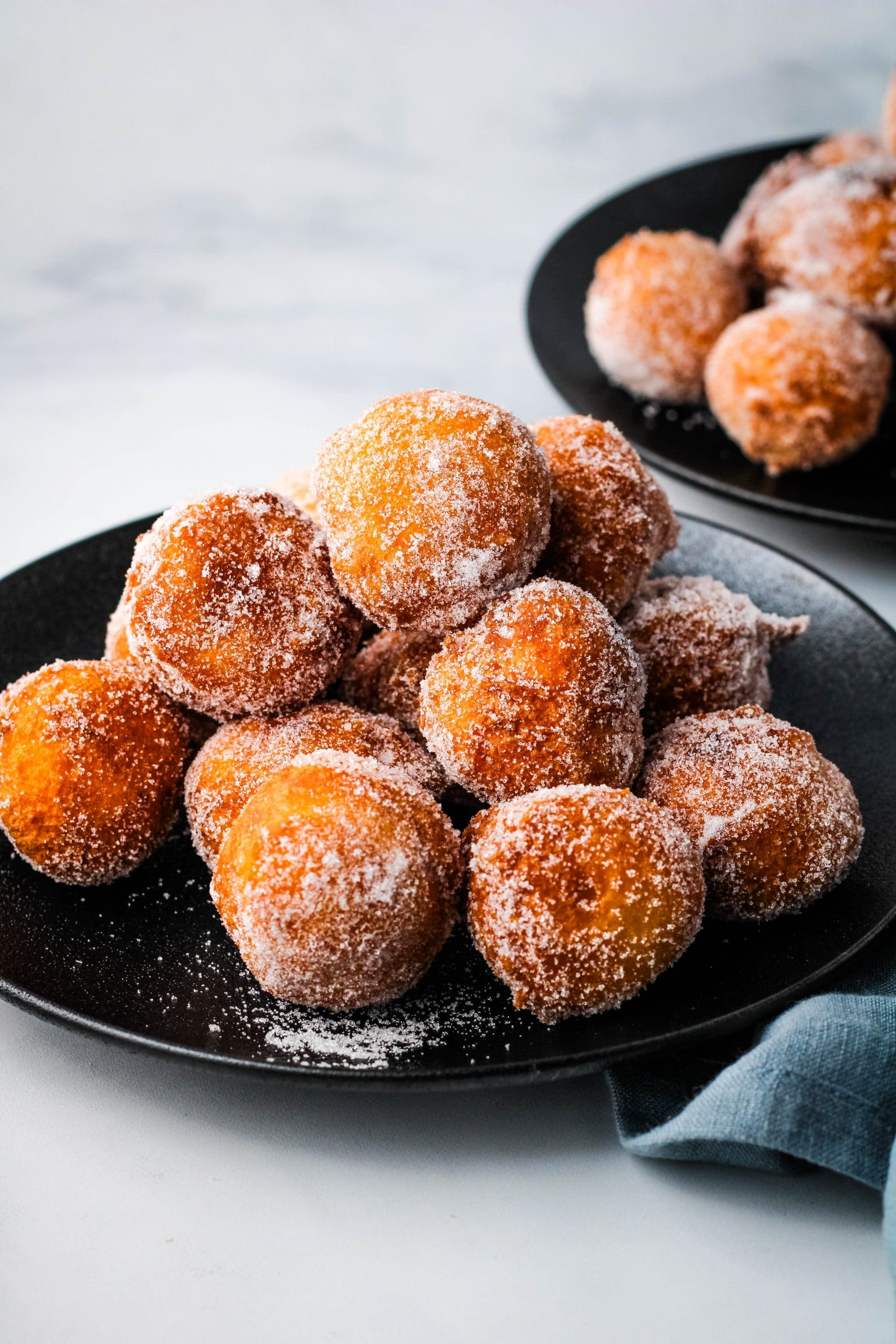 mochi donuts on a black plate