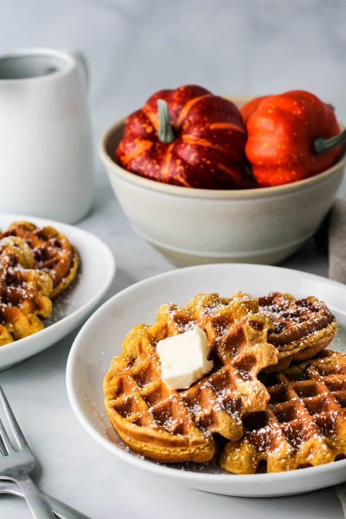 pumpkin mochi waffles on a white plate