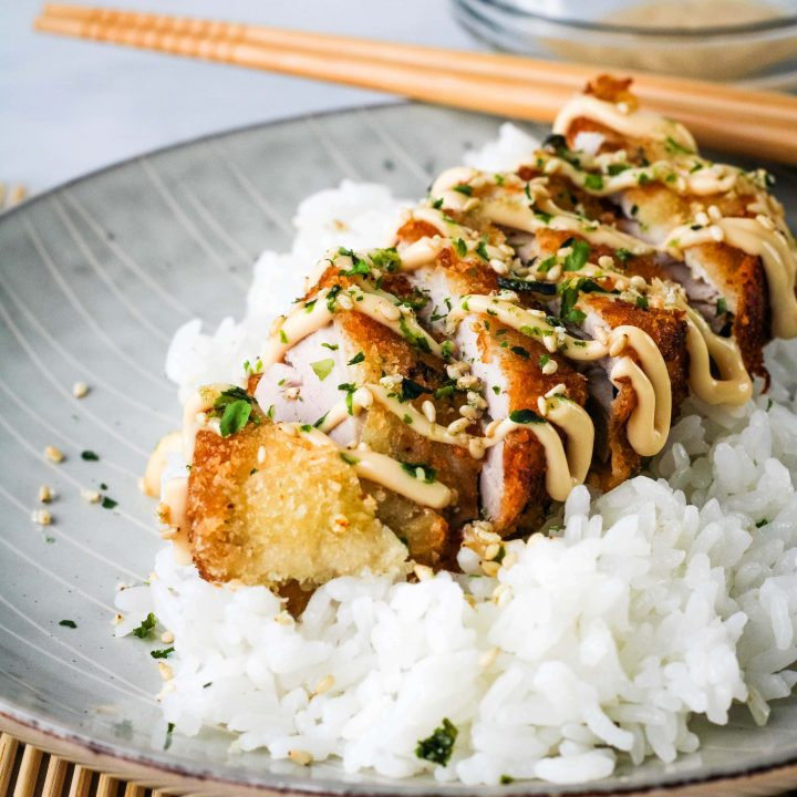 ahi katsu with unagi aioli with rice on a plate