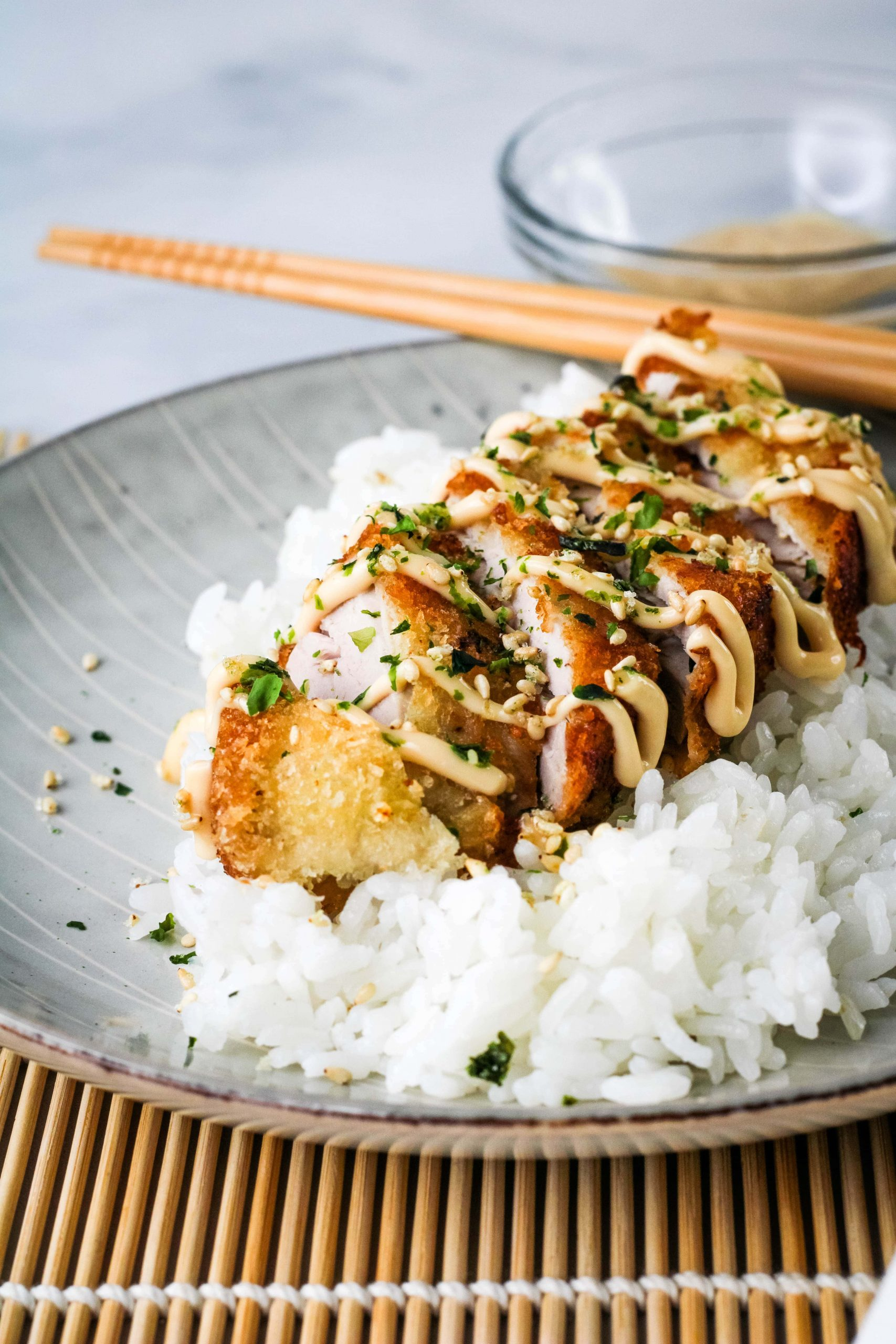 ahi katsu with unagi aioli with rice on a plate