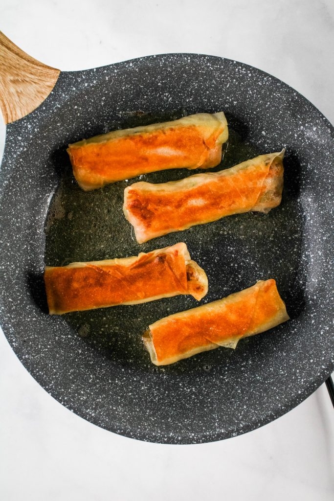 thanksgiving leftover lumpia in a frying pan