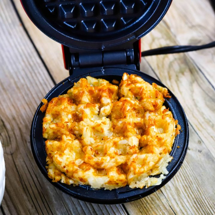 tater tot waffles in a waffle iron