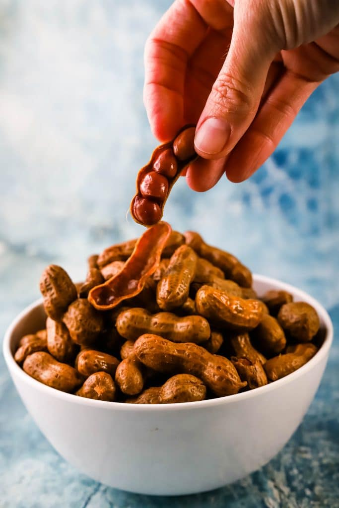 hand picking up instant pot boiled peanuts