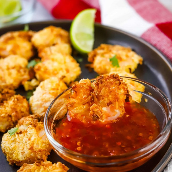 air fryer coconut shrimp on a plate with dipping sauce