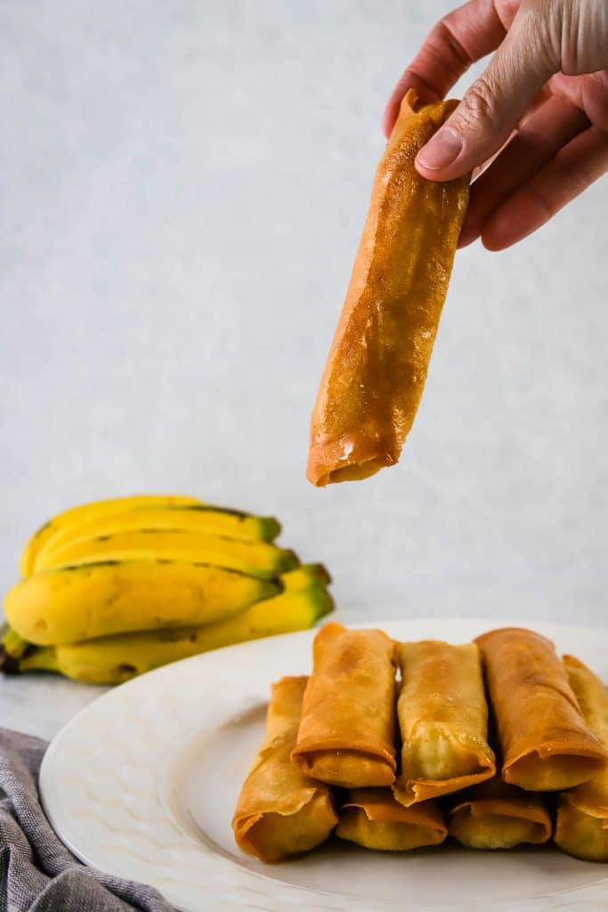 hand picking up banana lumpia