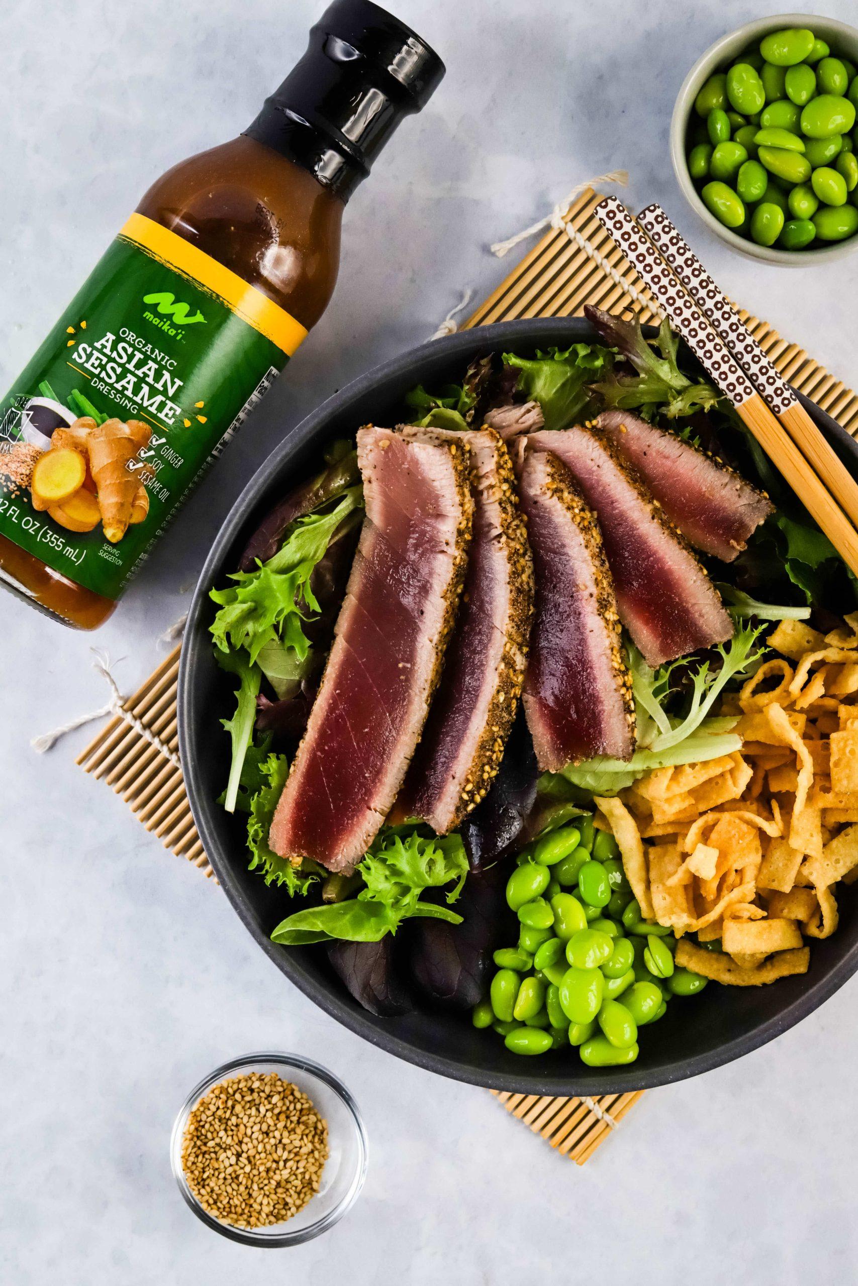 seared ahi salad on a black plate