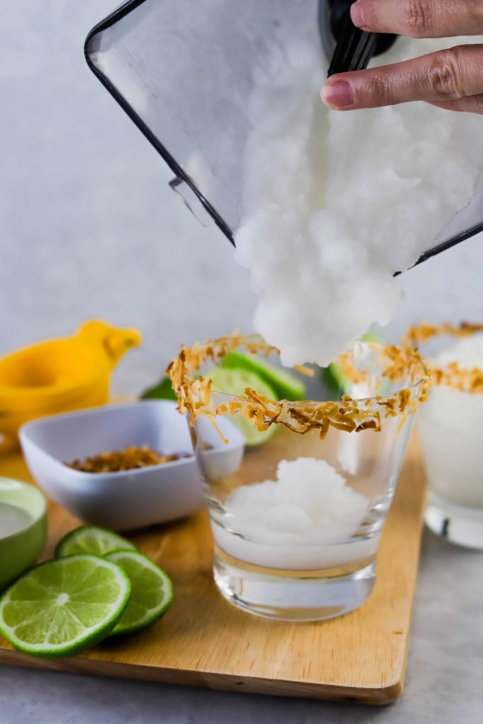 pouring a frozen coconut margarita
