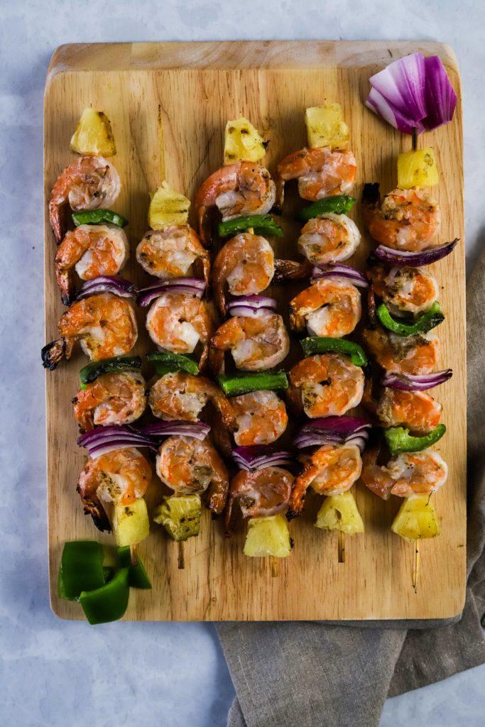 grilled shrimp kabob on a cutting board