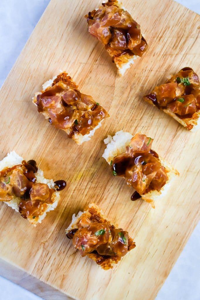top down spicy tuna crispy rice on a cutting board