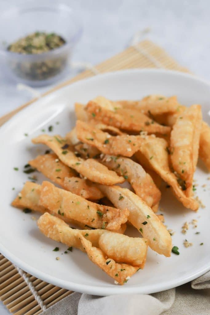 fried wonton strips on a white plate