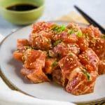 spicy ahi poke on a white plate